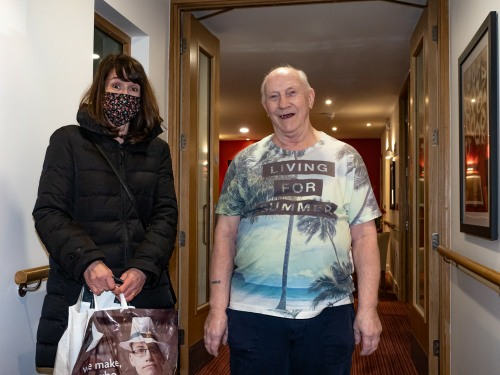 Jane delivering shopping to Michael, a vulnerable resident